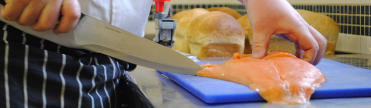student demonstrating skills learnt on one of our catering and hospitality courses