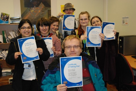 Community Reporters recieve their certificates