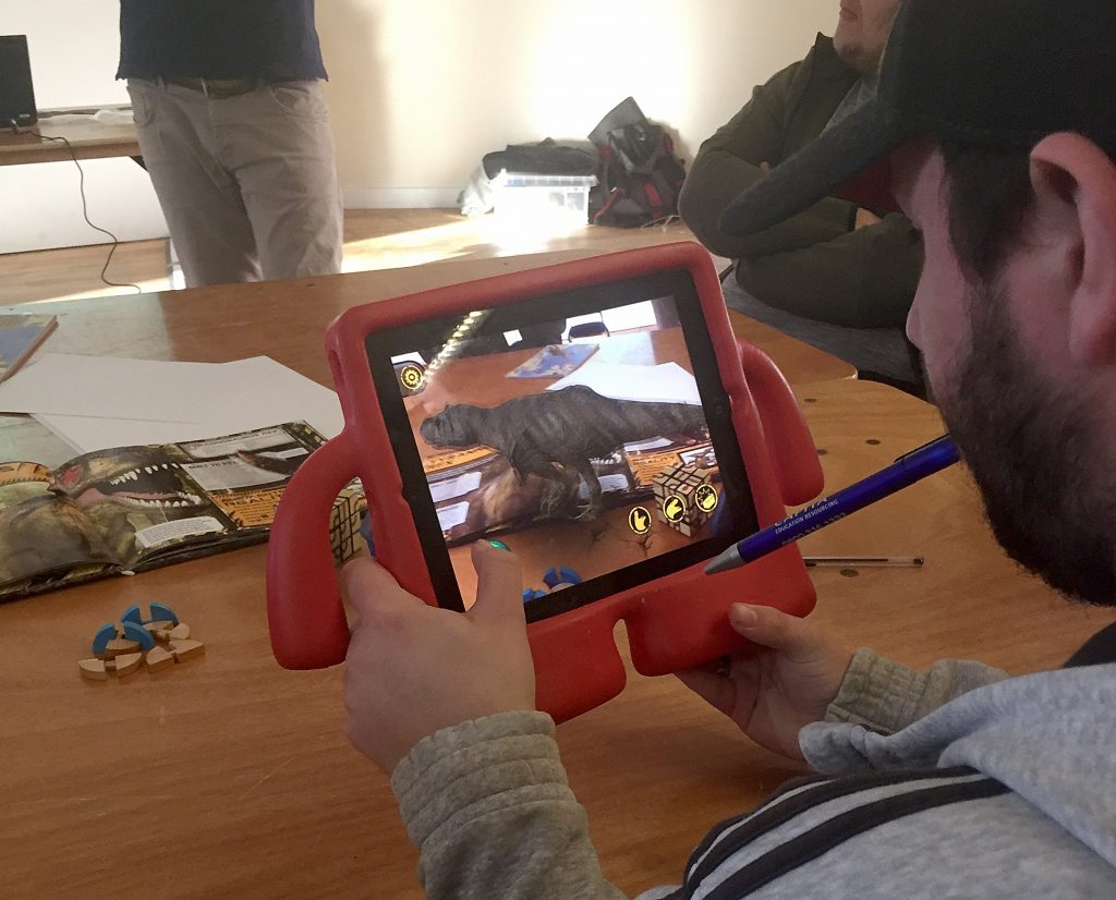 Trying out augmented reality with a dinosaur book that brings dinosaurs to life.