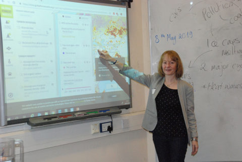 Dr. Stefania Amici showing students information about forest fires on earth