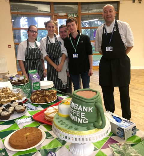 Catering and Hospitality students with tutor Alan Harris with their cakes to raise funds for macmillan cancer care