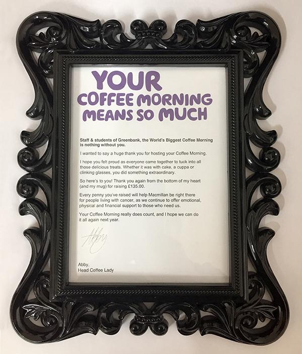 Certificate from Macmillan in a black ornate frame