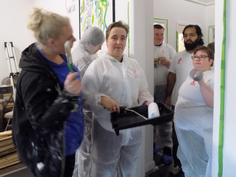 Group of students with decorating equipment ready to start their volunteering work