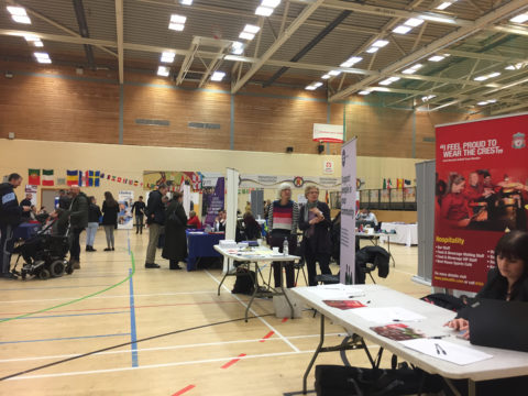 Large sports hall with stallholders and visitors