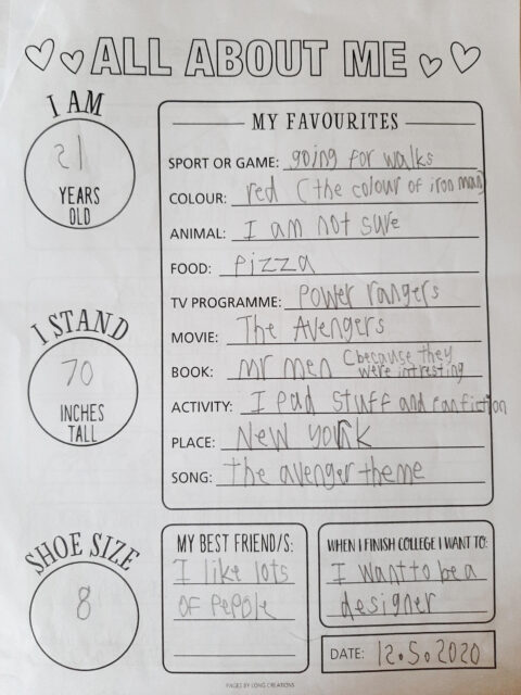 Student writing all about themselves in their Time Capsule Project