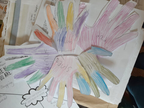 Colourful hand outlines of a family as part of the Time Capsule Project